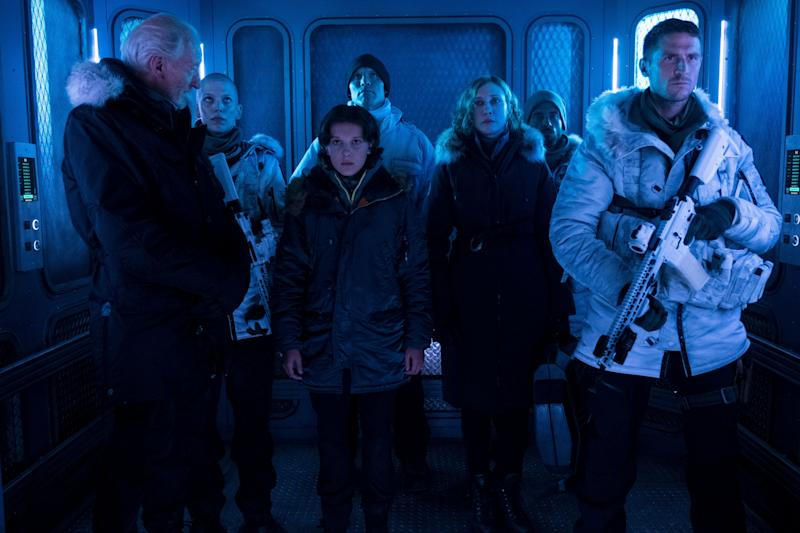 "(L-R) CHARLES DANCE as Alan Jonah, TRACIE GARRISON as Asaj, MILLIE BOBBY BROWN as Madison Russell, ZAC ZEDALIS as Sergeant Travis, VERA FARMIGA as Dr. Emma Russell, JOSHUA LEARY as Sergeant Baker and JONATHAN HOWARD as Asher Jonah ""GODZILLA: KING OF THE MONSTERS,"" a Warner Bros. Pictures release."