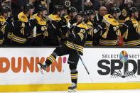 Boston Bruins' Anders Bjork is congratulated at the bench after scoring against the Washington Capitals during the first period of an NHL hockey game Monday, Dec. 23, 2019, in Boston. (AP Photo/Winslow Townson)