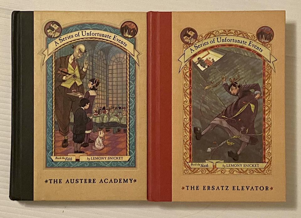 Two Series of Unfortunate Events books side by side. One with green spine, one red