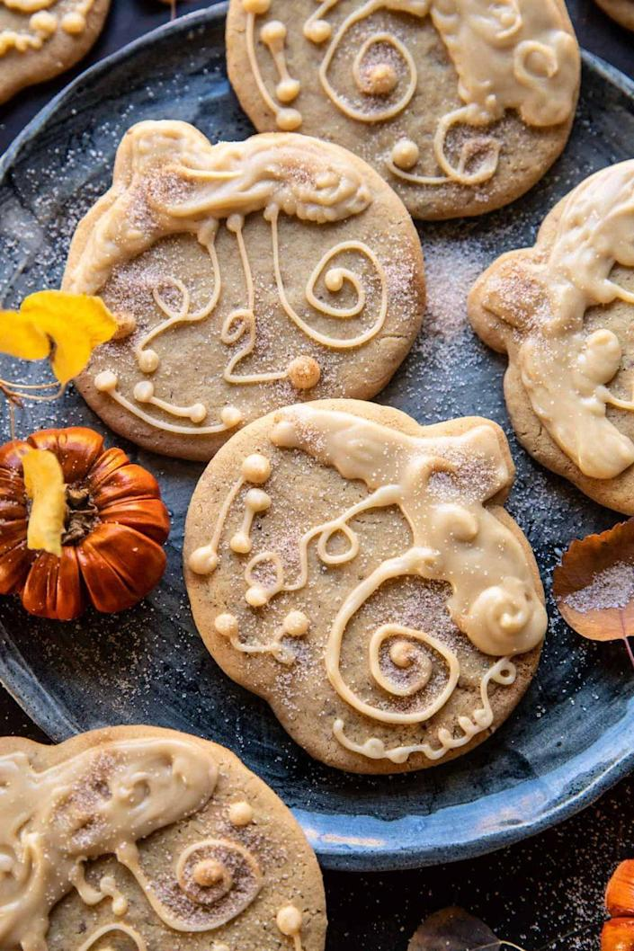 """<p>These pretty pumpkins are made with brown sugar and maple for a dessert that'll satisfy your sweet tooth. </p><p><strong>Get the recipe at <a href=""""https://www.halfbakedharvest.com/brown-sugar-maple-cookies/"""" rel=""""nofollow noopener"""" target=""""_blank"""" data-ylk=""""slk:Half-Baked Harvest"""" class=""""link rapid-noclick-resp"""">Half-Baked Harvest</a>. </strong> </p>"""