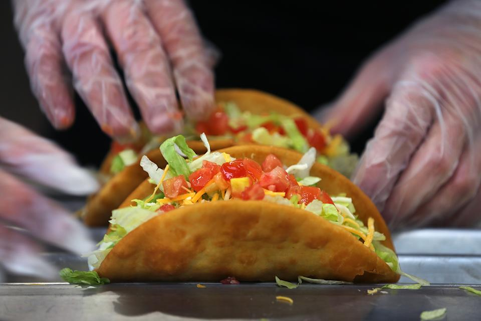 BOSTON, MA - DECEMBER 4: Tacos are made to order at the new Taco Bell Cantina in Brookline, MA on Dec. 4, 2020. The new Taco Bell on Boston University's campus on Commonwealth Ave. served alcohol. (Photo by John Tlumacki/The Boston Globe via Getty Images)