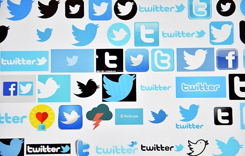 Twitter reports sluggish revenue and user growth, with widening losses in the past quarter (AFP Photo/LOIC VENANCE)