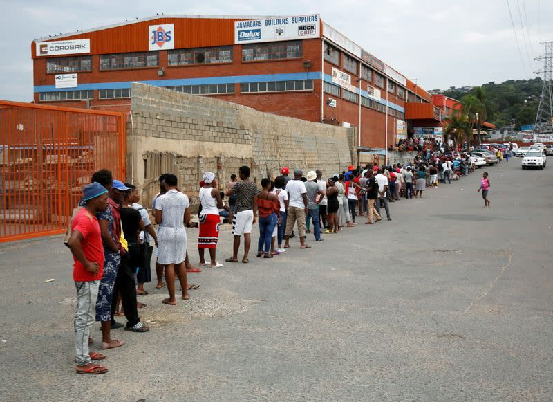 FILE PHOTO: Shoppers queue at a grocery store during a nationwide 21 day lockdown in an attempt to contain the coronavirus disease (COVID-19) outbreak in Umlazi township near Durban