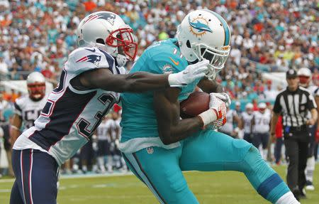 Jan 3, 2016; Miami Gardens, FL, USA; New England Patriots defensive back Devin McCourty (32) moves in as Miami Dolphins wide receiver DeVante Parker (11) makes a catch this second quarter touchdown at Sun Life Stadium. Mandatory Credit: Andrew Innerarity-USA TODAY Sports / Reuters Picture Supplied by Action Images