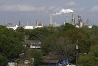 Homes are seen with The Valero Houston Refinery in the background on Monday, March 23, 2020, in Houston. The Texas Gulf Coast is the United States' petrochemical corridor, with four of the country's 10 biggest oil and gas refineries and thousands of chemical facilities. (AP Photo/David J. Phillip)