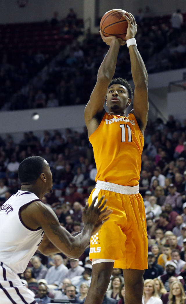 Tennessee forward Kyle Alexander (11) shoots over Mississippi State's Eli Wright during the first half an NCAA college basketball game in Starkville, Miss., Tuesday, Feb. 27, 2018. (AP Photo/Rogelio V. Solis)