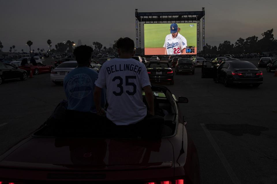 Fans watch Game 1 of the World Series during a drive-in viewing at Dodger Stadium.