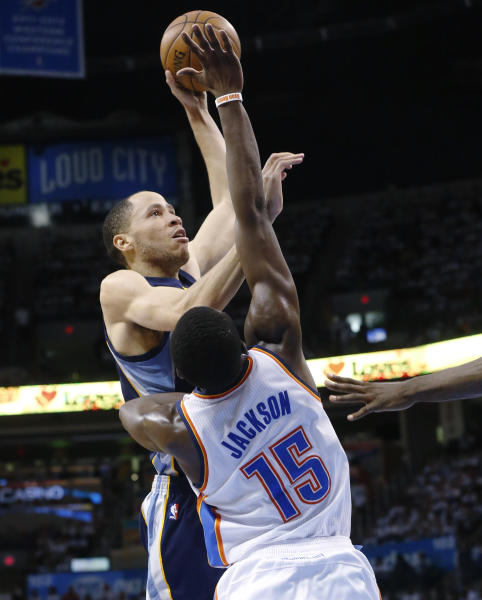 Memphis Grizzlies forward Tayshaun Prince (21) shoots over Oklahoma City Thunder guard Reggie Jackson (15) during the first half of Game 5 of an NBA basketball playoffs Western Conference semifinal, in Oklahoma City, Wednesday, May 15, 2013. (AP Photo/Sue Ogrocki)