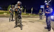 Israeli security forces are seen in a street in Lod near Tel Aviv on May 12