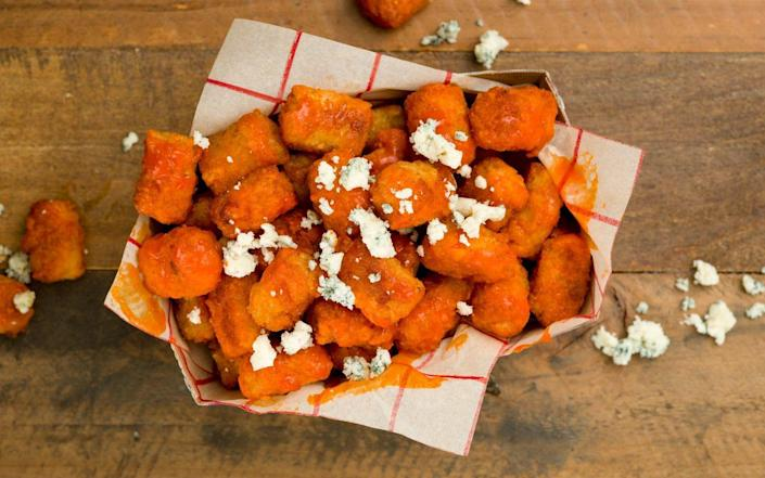 """<p>This is how you make tater tots grow up with you.</p><p>Get the recipe from <a href=""""https://www.delish.com/cooking/recipe-ideas/recipes/a45646/buffalo-ranch-tots/"""" rel=""""nofollow noopener"""" target=""""_blank"""" data-ylk=""""slk:Delish"""" class=""""link rapid-noclick-resp"""">Delish</a>.</p>"""