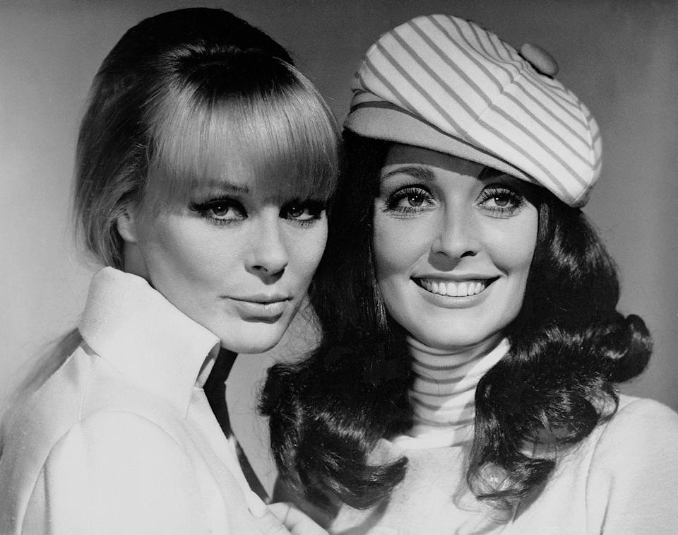 <p>Tate strayed from her signature blonde bangs for her film <em>The Wrecking Crew</em>, in which she wore a curly brunette wig. </p>
