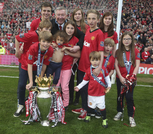 MANCHESTER, ENGLAND - MAY 12: Manager Sir Alex Ferguson of Manchester United squad celebrates with his grandchildren after the Barclays Premier League match between Manchester United and Swansea at Old Trafford on May 12, 2013 in Manchester, England. (Photo by John Peters/Man Utd via Getty Images)