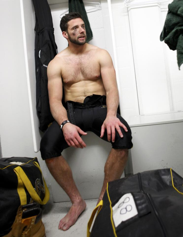 The Hamilton Tiger-Cats Andy Fantuz sits in the dressing room after their loss to the Saskatchewan Roughriders in the CFL's 101st Grey Cup championship football game in Regina, Saskatchewan November 24, 2013. REUTERS/David Stobbe (CANADA - Tags: SPORT FOOTBALL)