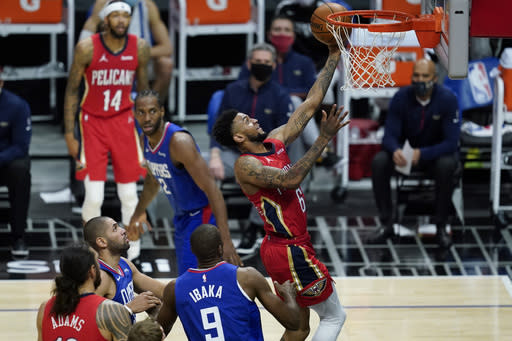 New Orleans Pelicans guard Nickeil Alexander-Walker (6) shoots past Los Angeles Clippers center Serge Ibaka (9) during the second quarter of an NBA basketball game Wednesday, Jan. 13, 2021, in Los Angeles. (AP Photo/Ashley Landis)