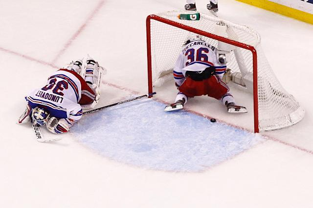 BOSTON, MA - MAY 16: Henrik Lundqvist #30 of the New York Rangers and Mats Zuccarello #36 of the New York Rangers lie on the ice after giving up the game-winning overtime goal by Brad Marchand (not pictured) of the Boston Bruins in Game One of the Eastern Conference Semifinals during the 2013 NHL Stanley Cup Playoffs on May 16, 2013 at TD Garden in Boston, Massachusetts. (Photo by Jared Wickerham/Getty Images)
