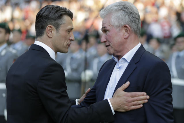 Frankfurt coach Niko Kovac, left, talks to Bayern coach Jupp Heynckes as he arrives for the German soccer cup final match between FC Bayern Munich and Eintracht Frankfurt in Berlin, Germany, Saturday, May 19, 2018. (AP Photo/Michael Sohn)
