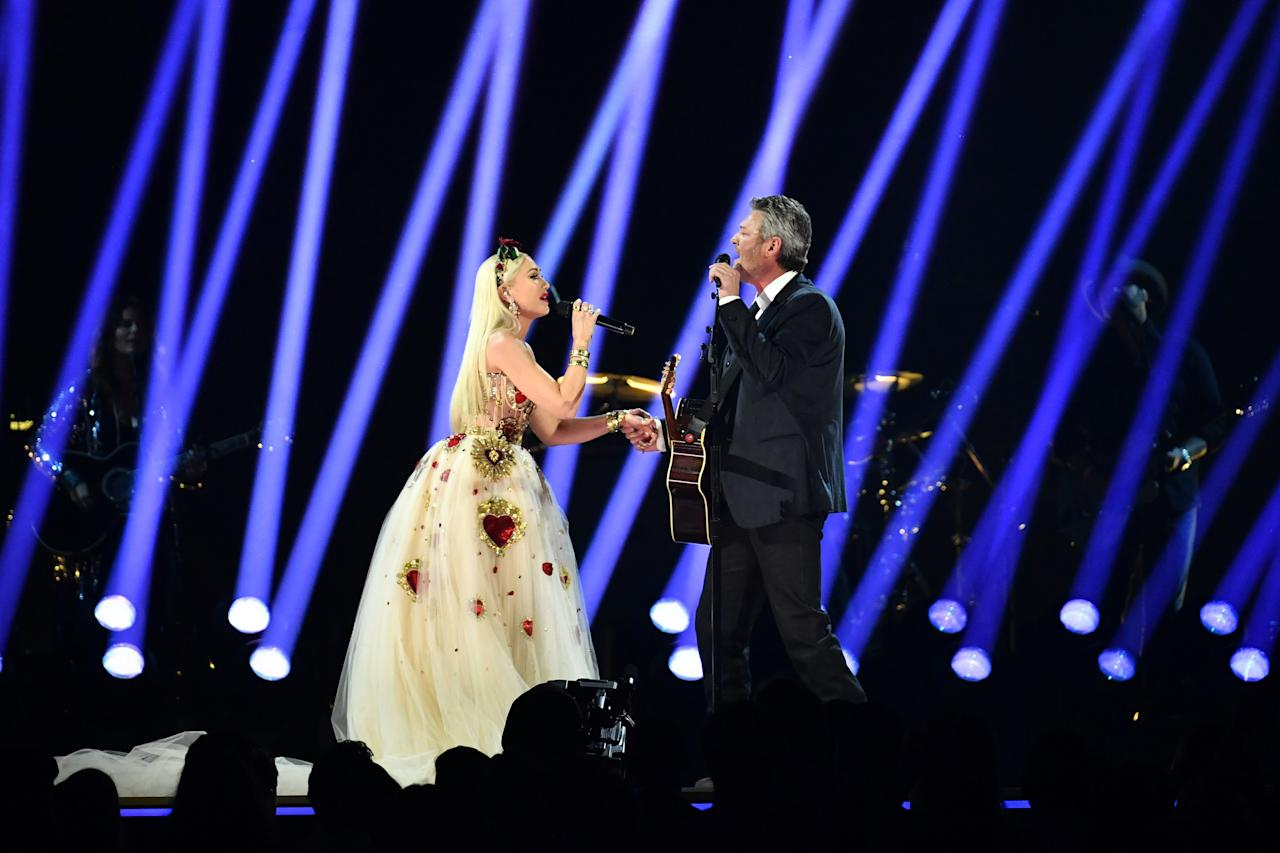 """<a href=""""https://people.com/tag/blake-shelton/"""">Shelton</a> and<a href=""""https://people.com/tag/gwen-stefani/"""">Stefani</a>hit the<a href=""""https://people.com/tag/grammy-awards/"""">2020 Grammy Awards</a>stage to perform their love song """"<a href=""""https://www.amazon.com/Nobody-But-Duet-Gwen-Stefani/dp/B081ZJX9RC/ref=sr_1_1?ie=UTF8&camp=1789&creative=9325&linkCode=as2&creativeASIN=B081ZJX9RC&tag=people0d0-20&ascsubtag=0e430a558beb96ea01422c43f22402b1"""">Nobody But You</a>"""" for the first time.  Shelton took the stage first, singing solo with a guitar in hand. Stefani joined him midway through, walking out in a sheer white ballgown with an embellished Queen of Hearts-motif corset and matching headband.  The couple played up the romance during the performance, facing each other and locking eyes as they sang. At one point, Stefani grabbed Shelton's hand as they finished singing the love ballad."""