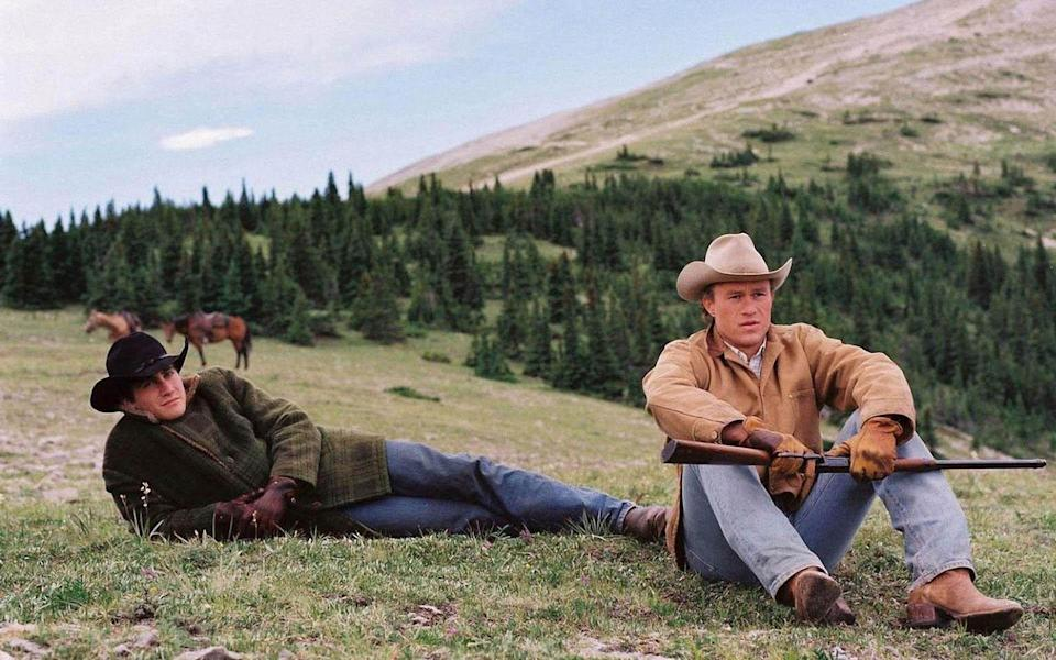 """<p>In 1963, Ennis Del Mar (Heath Ledger) and Jack Twist (Jake Gyllenhaal) spend time herding sheep in a remote mountain in Wyoming. They return completely changed. <em>Brokeback Mountain </em>is a gorgeous tear-jerker.</p><p><a class=""""link rapid-noclick-resp"""" href=""""https://www.amazon.com/Brokeback-Mountain-Heath-Ledger/dp/B000I9TXK6?tag=syn-yahoo-20&ascsubtag=%5Bartid%7C10072.g.33383086%5Bsrc%7Cyahoo-us"""" rel=""""nofollow noopener"""" target=""""_blank"""" data-ylk=""""slk:Watch Now"""">Watch Now</a></p>"""