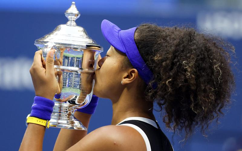 Naomi Osaka of Japan kisses the trophy in celebration after winning her Women's Singles final match against Victoria Azarenka of Belarus on Day Thirteen of the 2020 US Open at the USTA Billie Jean King National Tennis Center on September 12, 2020 in the Queens borough of New York City. - GETTY IMAGES