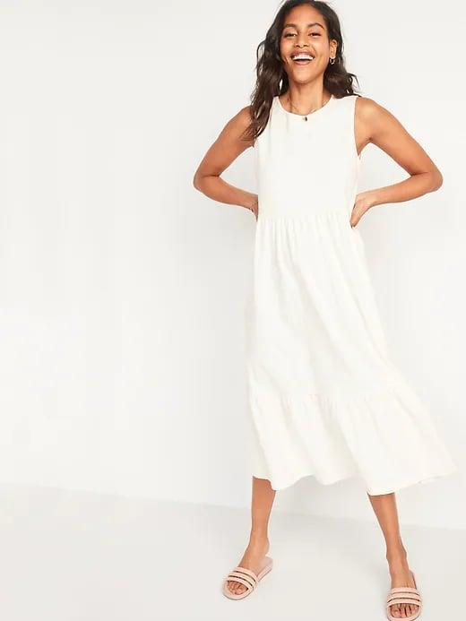 <p>There's something so summery about a cream outfit, and this <span>Old Navy Sleeveless Fit &amp; Flare Tiered Slub-Knit Midi Dress</span> ($35) is no exception.</p>
