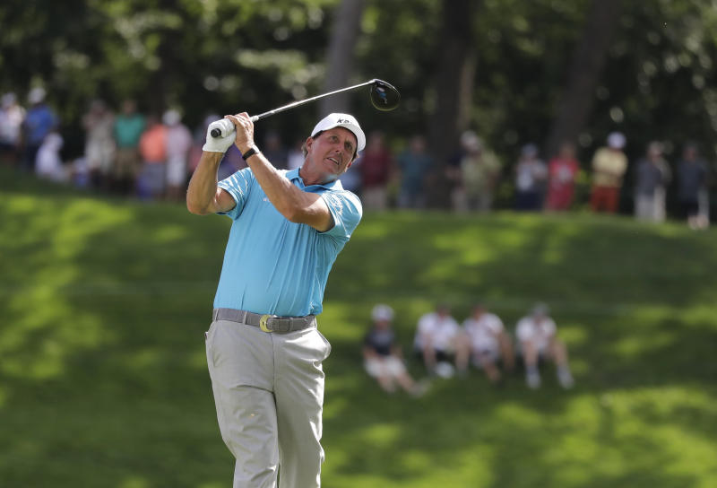 Phil Mickelson watches his tee shot on the 18th hole during the second round of the BMW Championship golf tournament at Medinah Country Club, Friday, Aug. 16, 2019, in Medinah, Ill. (AP Photo/Nam Y. Huh)