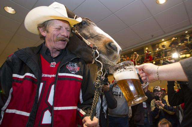 Tuffy and Fletcher Armstrong receive some beer inside the Holiday Inn. (Ben Nelms/Reuters.)