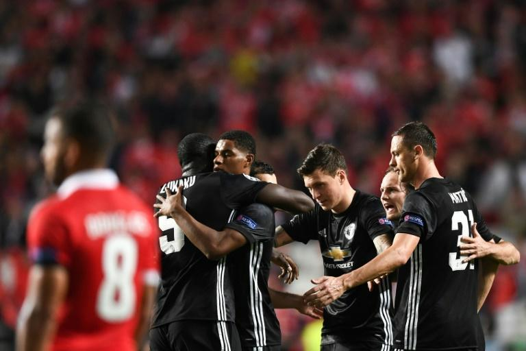 Manchester United's Marcus Rashford (3L) celebrates his goal during their Champions League match against Benfica in Lisbon on Ocotber 18, 2017