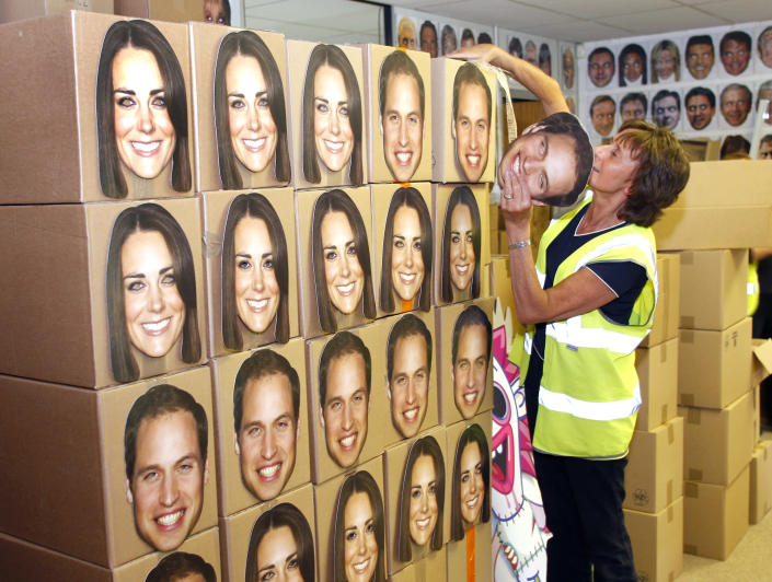 Pam Cooper from the Mask-arade mask company loads boxes of Prince William and Kate, Duchess of Cambridge masks ready for dispatch at the company works in Southam , England Thursday June 6, 2013. Mask-arade are in overdrive printing masks of Kate and William for the street parties that will follow the announcement of the birth of the Royal baby, expected in July. Normally, the company has 2,000 masks on hand. But for the royal birth, they will whip up 20,000 to meet the expected demand. (AP Photo/Martin Cleaver)
