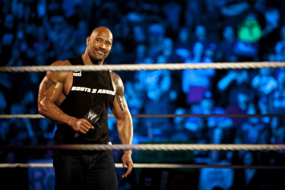 Dwayne Johnson, aka The Rock, enters the ring to talk smack about his upcoming opponent John Cena during the WWE Raw event at Rose Garden arena in Portland, Ore., Monday February 27th, 2012. (Photo by Chris Ryan/Corbis via Getty Images)