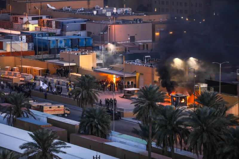 Protestors set fire to an entry control point at the U.S. Embassy in Baghdad