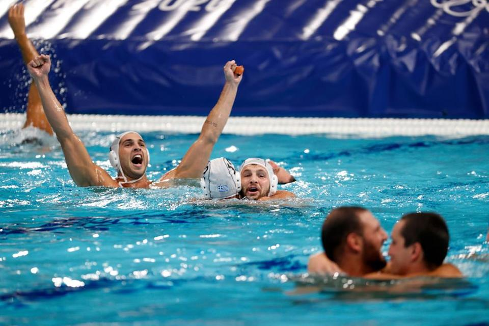 Players of Greece celebrate after their semi-final win.