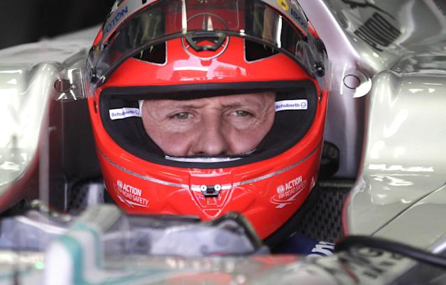 """FILE - In this Nov. 23, 2012 file photo, Grand Prix driver Michael Schumacher, of Germany, sits in his car during a free practice at the Interlagos race track in Sao Paulo, Brazil. French investigators have ruled out any criminal wrongdoing in the debilitating ski accident of Formula One great Michael Schumacher, a state prosecutor said Monday, Feb. 17, 2014. Albertville prosecutor Patrick Quincy said """"no infraction by anyone has been turned up"""" and the probe has been closed, his office said in a statement responding to questions about whether the Meribel ski station in the French Alps or an equipment maker might have had some role in Schumacher's injury. (AP Photo/Victor Caivano, File)"""