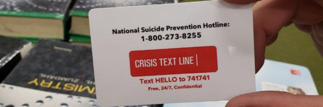 Suicide prevention info on the back of a student ID in California
