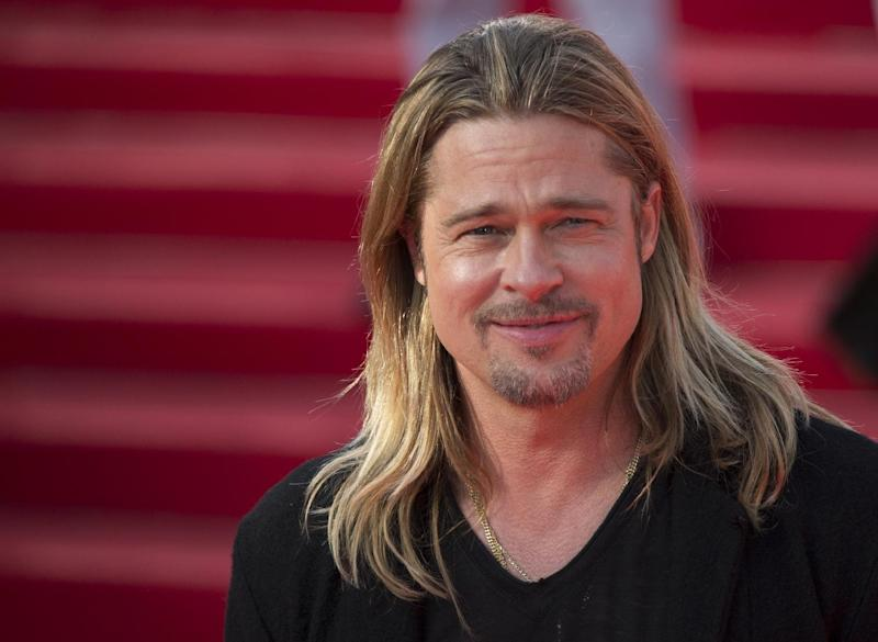 "U.S. actor Brad Pitt poses on the red carpet prior the ""World War Z"" premiere at the opening ceremony of the 35th Moscow international film festival in Moscow, Russia, Thursday, June 20, 2013. (AP Photo/Alexander Zemlianichenko Jr)"