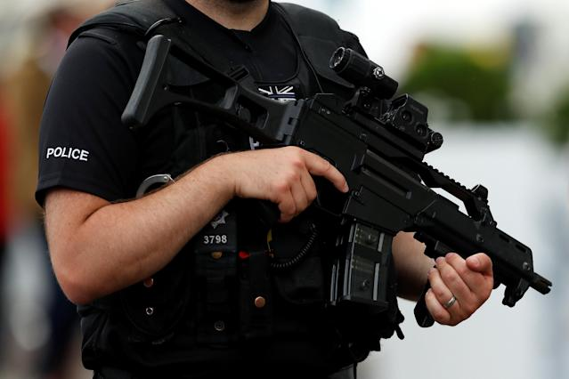 Horse Racing - Derby Festival - Epsom Downs Racecourse, Epsom, Britain - June 1, 2018 A general view of armed police during Ladies Day Action Images via Reuters/Andrew Boyers