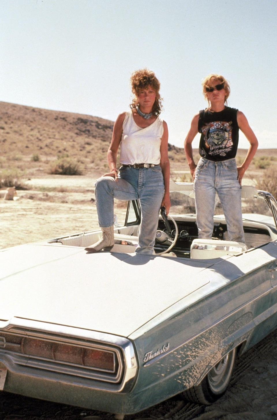 <ul> <li><strong>What to wear for Thelma:</strong> Sunglasses, light boot-cut jeans, and a graphic black tank top.</li> <li><strong>What to wear for Louise:</strong> Blue jeans, a white tank top, and a cowboy hat with a handkerchief tied around your neck. Get dusty.</li> </ul>