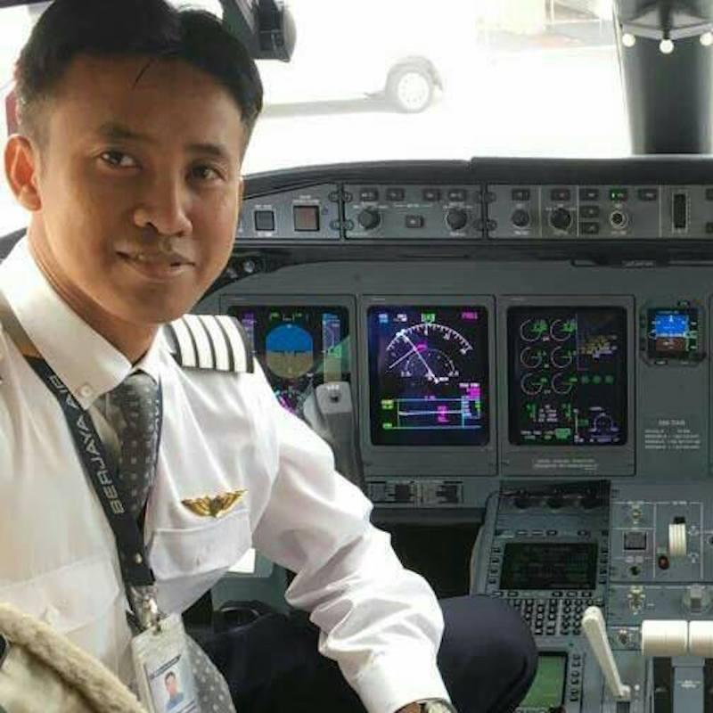 Capt Muhammad Fauwaz Zamzam is seated in the cockpit of a private jet in this undated picture taken from his personal Facebook page.