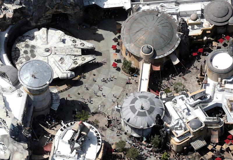 Crowds walk near the Millennium Flacon spaceship inside Star Wars: Galaxy's Edge at Disney's Hollywood Studios on the final day before closing in an effort to combat the spread of coronavirus disease (COVID-19), in an aerial view in Orlando, Florida, U.S. March 15, 2020. Picture taken March 15, 2020. REUTERS/Gregg Newton