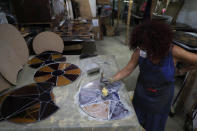 Artist Maya Hussaini works to recreate one of the stained-glass windows that were the trademark of Beirut's Sursock Museum, shattered in last year's port explosion, at her studio in Beirut, Lebanon, Monday, June 28, 2021. Lebanon's only modern art museum, the Sursock, was the beating heart of Beirut's arts community, and some hope that reopening it will be a first step in the harder task of rebuilding the city's once thriving arts scene. (AP Photo/Hussein Malla)