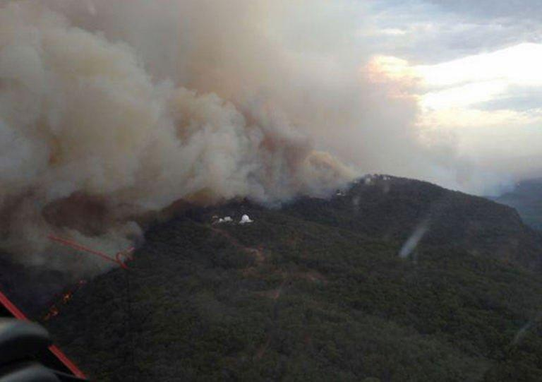 Photo taken on January 13, 2013 by the New South Wales Rural Fire Service (RFS) shows smoke billowing from a fire near the Siding Spring Observatory. Monitoring instruments at the main telescope showed temperatures surging above 100 degrees Celsius at the height of the danger