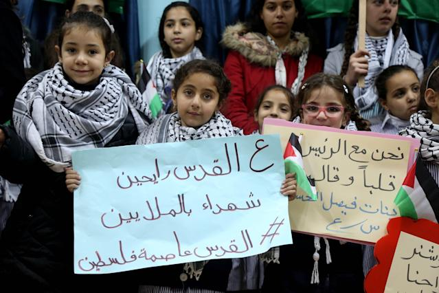 <p>Students hold placards as they protest the US President Donald Trump's intention to recognize Jerusalem as Israels capital, at Faisal Husseini school in Ramallah, West Bank on Dec. 6, 2017. (Photo: Issam Rimawi/Anadolu Agency/Getty Images) </p>