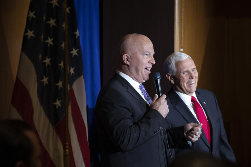 New York Police Commissioner James O'Neill, left, introduces Vice President Mike Pence during a visit with the NYPD's football team, Thursday, Sept. 19, 2019. Pence met earlier with the NYPD for a counterterrorism briefing. (AP Photo/Mark Lennihan)