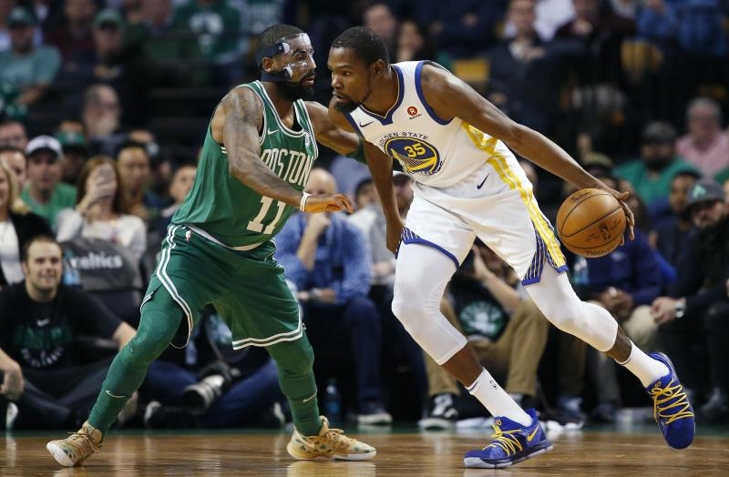 Golden State Warriors' Kevin Durant (35) drives past Boston Celtics' Kyrie Irving (11) during the first quarter of an NBA basketball game in Boston, Thursday, Nov. 16, 2017. (AP Photo/Michael Dwyer)