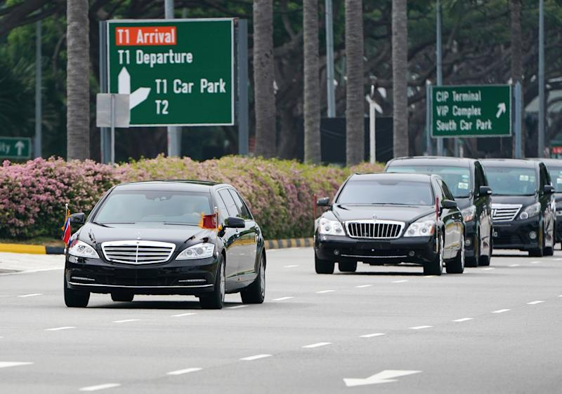 A motorcade believed to be carrying North Korea leader Kim Jong Un travels from the airport to the St. Regis Hotel in Singapore on Sunday. (Athit Perawongmetha / Reuters)