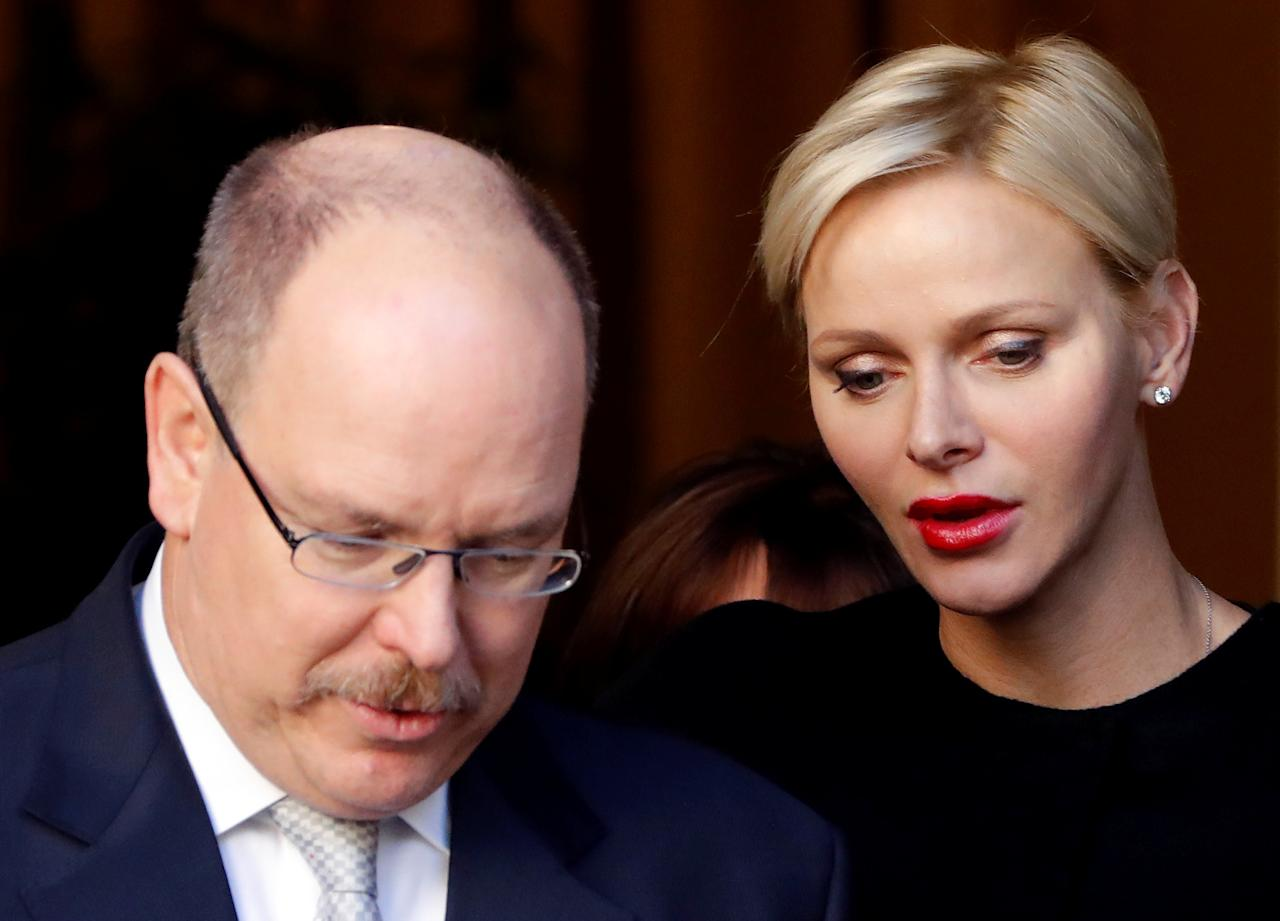 Prince Albert II (L) and Princess Charlene (R) of Monaco attend a gift-giving event to Monaco's resident at the headquarters of the Monaco Red Cross in Monaco, ahead of Monaco National Day November 17, 2017.       REUTERS/Eric Gaillard