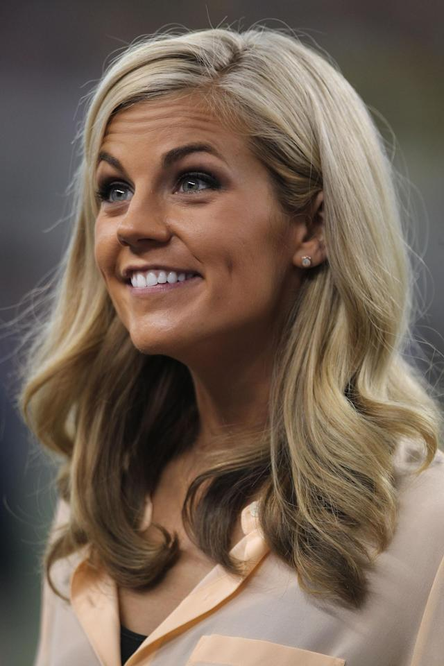 Samantha Steele smiles while reporting on a game between Michigan and Alabama.