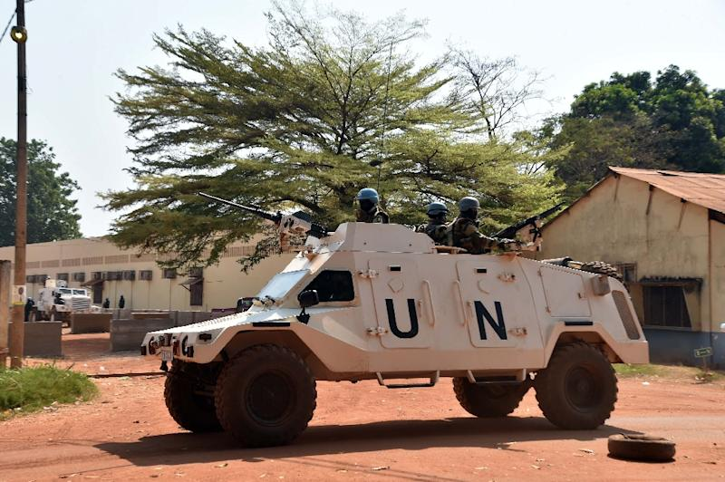 Peacekeepers from the MINUSCA mission of the United Nations patrol on January 2, 2016 in Bangui