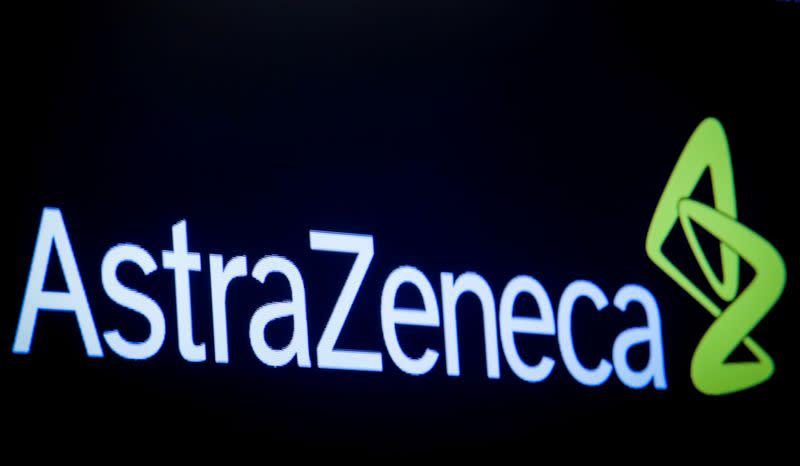 FILE PHOTO: The company logo for pharmaceutical company AstraZeneca is displayed on a screen on the floor at the NYSE in New York
