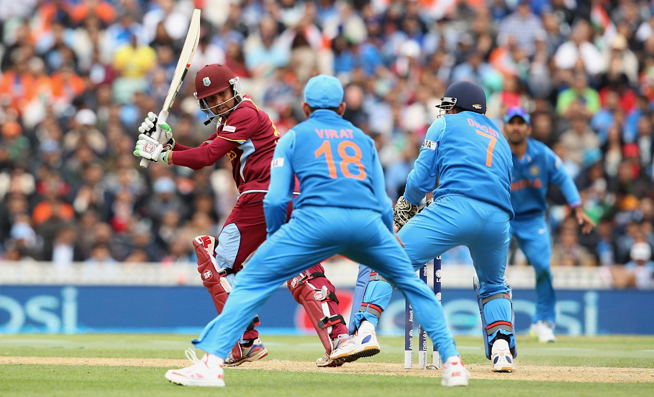 West Indies' Ramnaresh Sarwan is caught by India's Mahendra Singh Dhoni during the ICC Champions Trophy match at the Kia Oval, London.