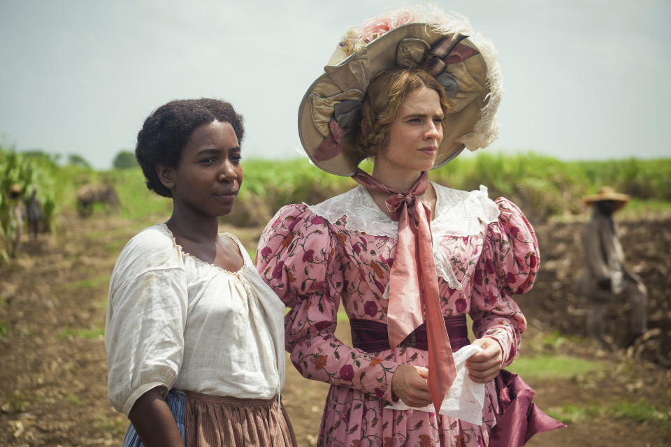 "This image released by PBS shows Tamara Lawrance, left, and Hayley Atwell in a scene from the miniseries ""The Long Song"" debuting Jan. 31 on ""Masterpiece."" (Carlos Rodriguez/Heyday Television-PBS via AP)"